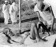 Gandhiji giving massage,to a leper patient, the Sanskrit scholar Parchure Shastri, at Sevagram Ashram in 1940. Source: Wikimedia Commons